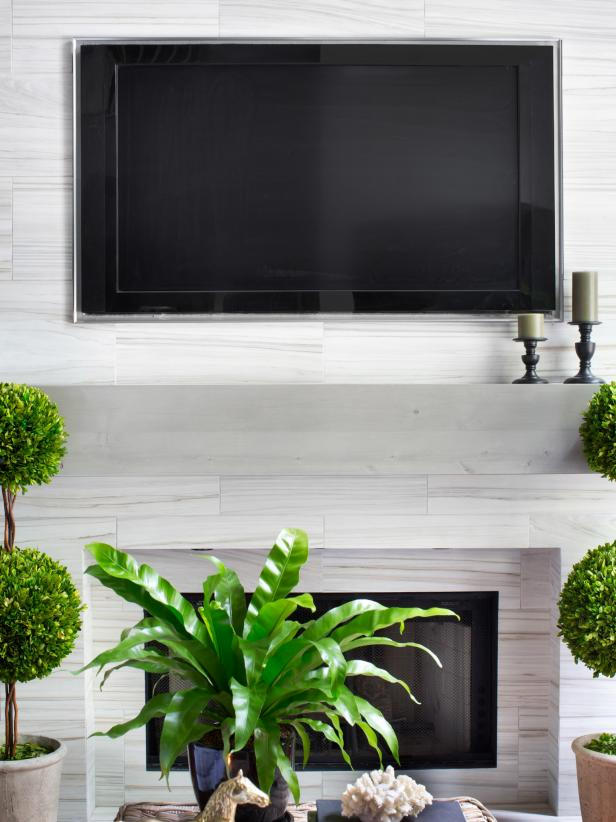 How high to mount tv over fireplace?